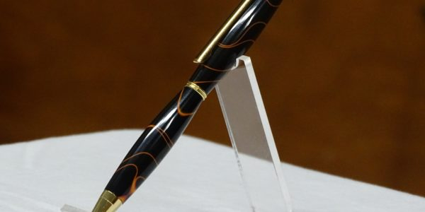 Gert Rosenau [R] received pen from Chad Shaw [L]