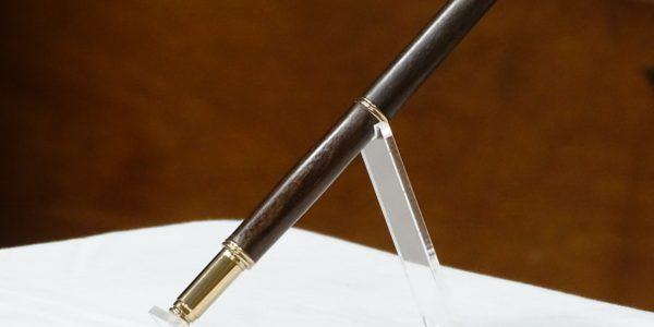 Rob Peros [R] received pen from John MacDonald [L]