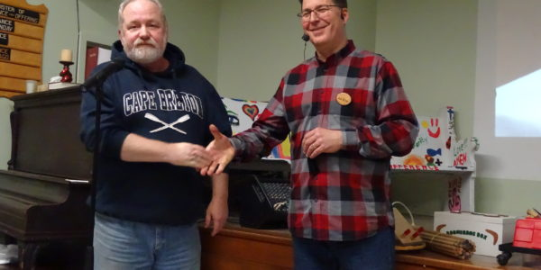 Rob Peros [R] received pen from John MacDonald [L]