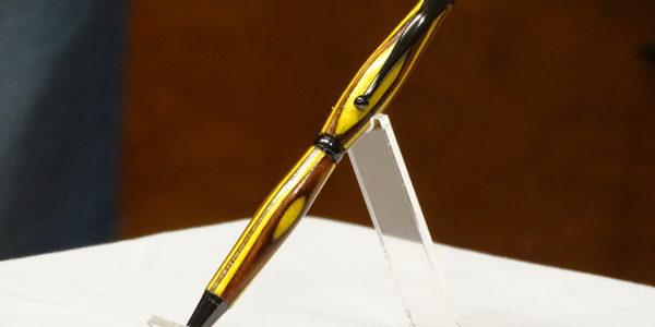 Wayne Pye [L] received pen from Dan Alexander [R]
