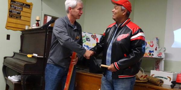 Dan Alexander [R] received pen from Jim Patterson [L]