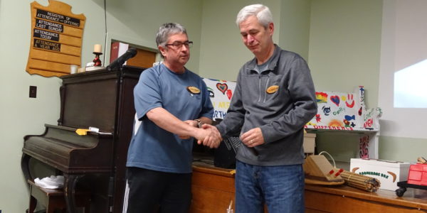 Jim Patterson [R] received pen from Gord Armstrong [L]