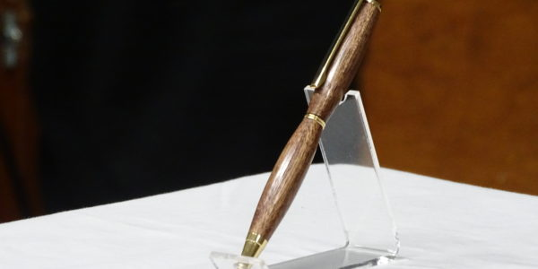 Gord Amrstrong [R] received pen from Wayne Pye [L]