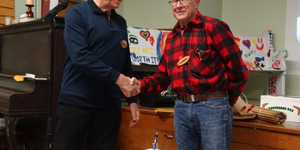 Wayne Pye [L] received pen from Dave Roberts [R]