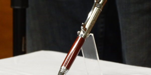Steve Hutcheon [L] received pen from Kade Bolger [R]
