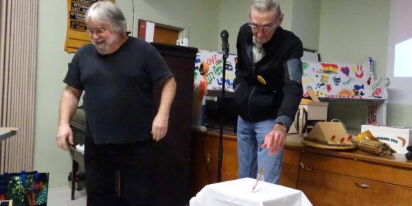 Don Gaudet [R] received pen from Steve Hutcheon [L]