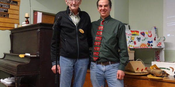 Paul Kidson [R] received pen from Don Gaudet [L]