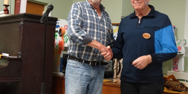 Rick Sullivan [L] received pen from Wayne Pye [R]